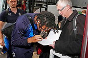 Wimbledon defender Toby Sibbick (20) signing autographs during the EFL Sky Bet League 1 match between Scunthorpe United and AFC Wimbledon at Glanford Park, Scunthorpe, England on 30 March 2019.