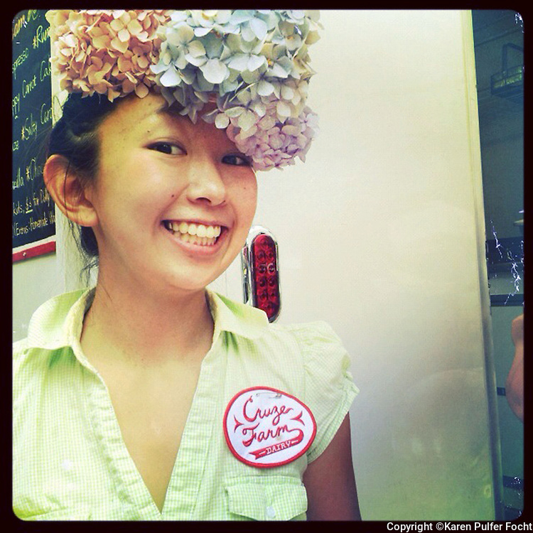 AYAKA NISHIJIMA gives out samples of ice cream at the Cruise Farm and Dairy milk bar at the Farmers Market in Knoxville, Tennessee.