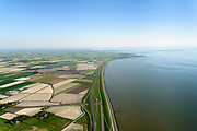 Nederland, Friesland, Gemeente S&uacute;dwest-Frysl&acirc;n, 07-05-2018; Fries Waddenkust ter hoogte van Kimswerd / Dijksterburen, gezien naar Zurich en met de Afsluitdijk in de achtergrond.<br /> Coast Wadden Sea.<br /> luchtfoto (toeslag op standaard tarieven);<br /> aerial photo (additional fee required);<br /> copyright foto/photo Siebe Swart