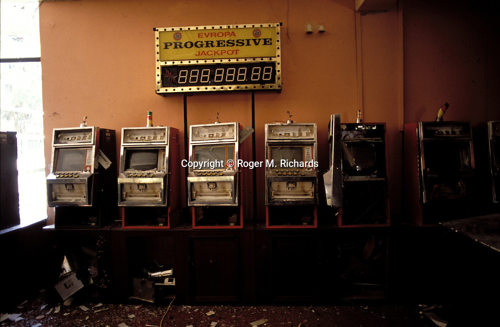 The slot machines in the casino of the destroyed Hotel Europa during the Bosnian Serb siege of Sarajevo, Bosnia and Herzegovina, 1993. Almost 2,000 children, and over 10,000 people in total were killed in Sarajevo during the 3-1/2 year siege. (Photo by Roger Richards)