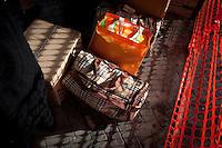 Luggages of passengers taking the last Trinacria are on the platform of the Palermo train station. The Trinacria express train is a historical train from Palermo, Sicily, to Milan, symbol of the emigration from South to the North.  From December 11th 2011 16 train connecting Southern Italy to the North will be cancelled by Trenitalia, the state-owned train operator in Italy. ### I bagagli dei passeggeri dell'ultimo treno Trinacria vengono depositati sulla banchina della stazione di Palermo. Il Trinacria è un treno storico che ha collegato Palermo e Milano, simbolo dell'emigrazione verso Nord. Dall'11 dicembre 2011 16 treni che collegano il Sud al Nord Italia verranno soppressi da Trenitalia.