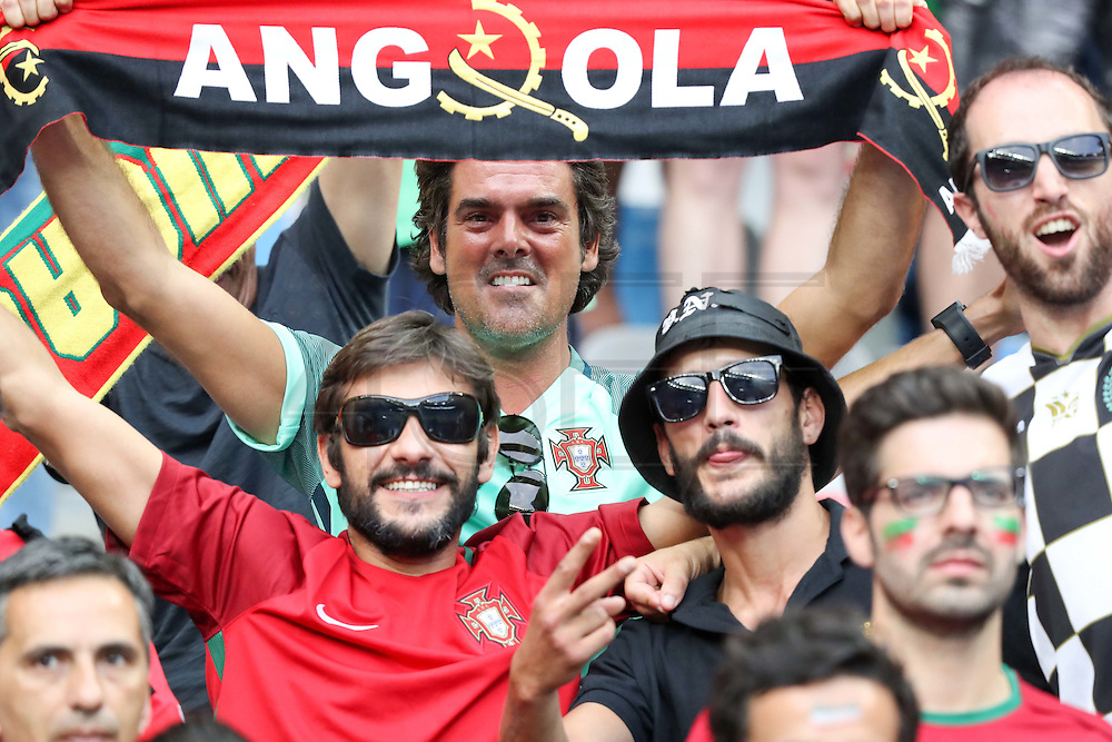 Portuguese supporters with an angolean scarf  before the beginning of the match. Portugal won the Euro Cup beating in the final home team France at Saint Denis stadium in Paris, after winning on extra-time by 1-0.