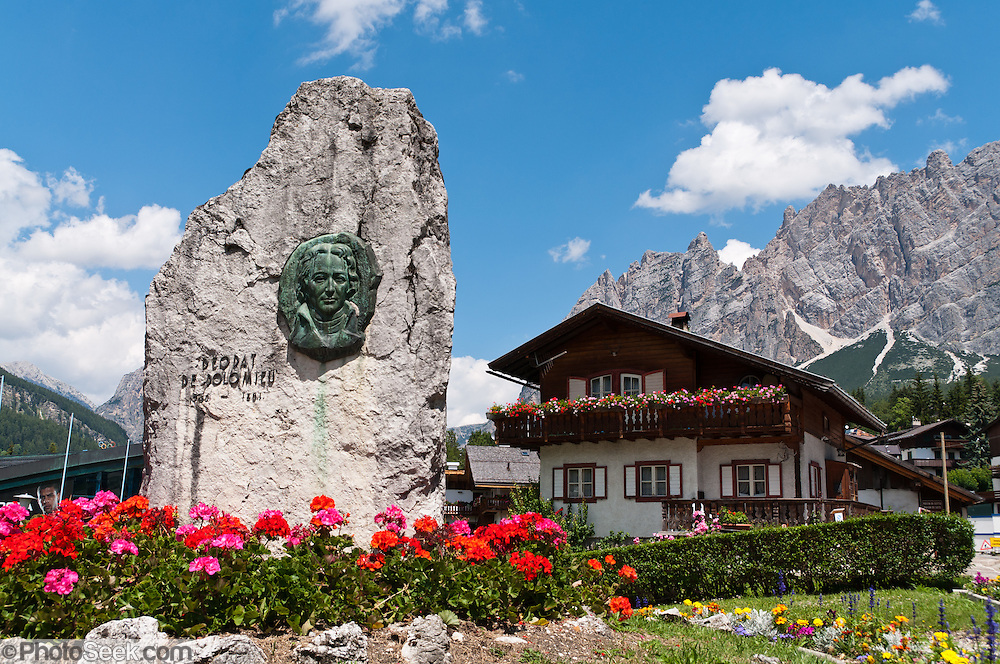 "The Dolomite mineral and mountains were named after French geologist Déodat de Dolomieu (1750-1801, also known as Dieudonné Sylvain Guy Tancrède de Dolomieu). The mountain town of Cortina d'Ampezzo (Ladin: Anpëz, German: Hayden, at 1224 meters / 4016 feet elevation) is surrounded by the Dolomites (Dolomiti, a part of the Southern Limestone Alps) at the top of Valle del Boite in the Province of Belluno, Veneto region, northern Italy. This ski resort hosted the 1956 Winter Olympics and motion pictures including: ""The Pink Panther"" (1963), ""For Your Eyes Only"" (1981, James Bond stunt sequences); and ""Cliffhanger"" (1993). Nearby peaks include the highest summit, Tofana di Mezzo (3244 m / 10,643 feet) in Tofane mountain group to the west, Pomagagnon to the north, Cristallo to the northeast, Faloria and Sorapiss to the east, and Becco di Mezzodì, Croda da Lago and Cinque Torri to south. The Dolomites were declared a natural World Heritage Site (2009) by UNESCO."