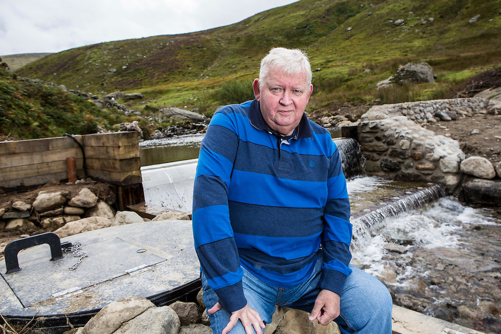 Hywel Thomas founding director of Ynni Anafon Energy at the weir of their new community hydro project.<br /> Ynni Anafon Energy, one of the largest community owned hydro projects in the UK. The site of the Anafon Hydro lies in the Anafon valley in the Carneddau massif which rises immediately south of the village of Abergwyngregyn just inside the northern boundary of the Snowdonia National Park and 4 km west-south-west of Llanfairfechan.