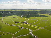 Nederland, Friesland, Gemeente Franekeradeel, 16-04-2012; Westergo, klassiek Fries landschap tussen Franeker en Bolsward, gekenmerkt door kleinschaligheid, aanwezigheid van terpen..Westergo, classic Frisian landscape between Franeker and Bolsward, characterized by small scale, presence of mounds.luchtfoto (toeslag), aerial photo (additional fee required).foto/photo Siebe Swart