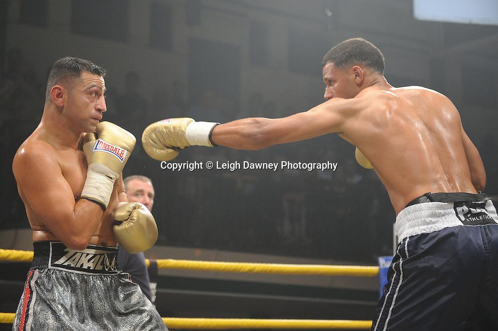 Robert Lloyd Taylor (charcoal shorts) defeats Mehrdud Takaloo at Quarter Final One  - The Light Middleweights II. York Hall, Bethnal Green, London, UK. 15th September 2011. Photo credit: © Leigh Dawney.