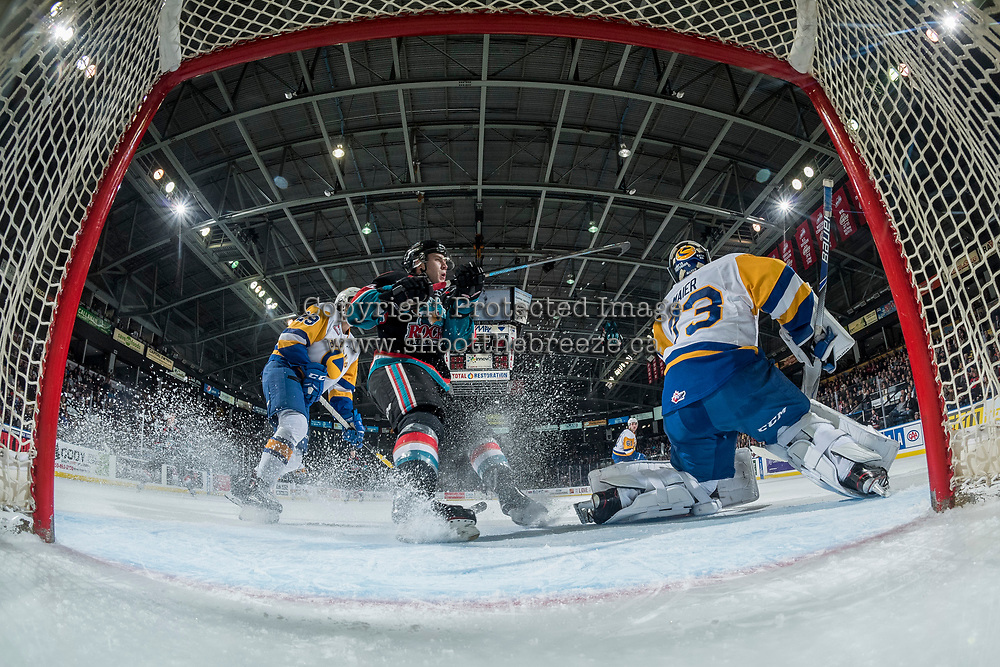 KELOWNA, CANADA - DECEMBER 1:  Kyle Topping #24 of the Kelowna Rockets skates into the crease behind Nolan Maier #73 of the Saskatoon Blades on December 1, 2018 at Prospera Place in Kelowna, British Columbia, Canada.  (Photo by Marissa Baecker/Shoot the Breeze)