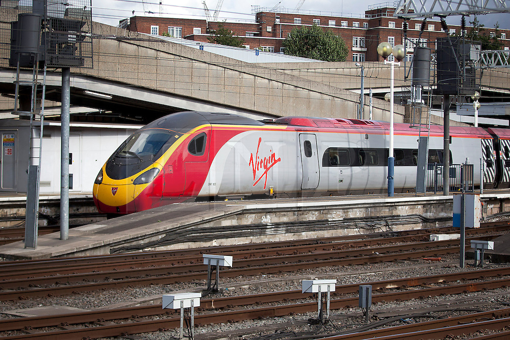 © Licensed to London News Pictures. 04/10/2012. LONDON, UK. A Virgin train is seen at Euston Station in London.  Photo credit: Matt Cetti-Roberts/LNP