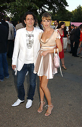 STEPHEN & ASSIA WEBSTER, he is the jeweller at the Serpentine Gallery Summer party sponsored by Yves Saint Laurent held at the Serpentine Gallery, Kensington Gardens, London W2 on 11th July 2006.<br />