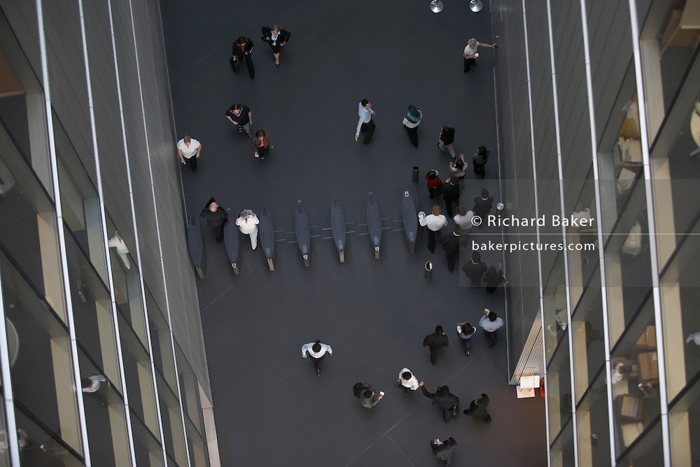 Employees walk through barriers of an auditing company 385,000 square foot London headquarters