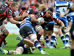 Dragons number 8 Toby Falatau is tackled in possession - Photo mandatory by-line: Patrick Khachfe/JMP - Tel: Mobile: 07966 386802 19/10/2013 - SPORT - RUGBY UNION - Recreation Ground - Bath - Bath V Newport Gwent Dragons - Amlin Challenge Cup