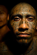 Jose Porfilio Vasquez Martines, 29, poses for a portrait in a cell he shares with over 40 other members of the Mara 18 gang in Izalco men's prison in El Salvador.