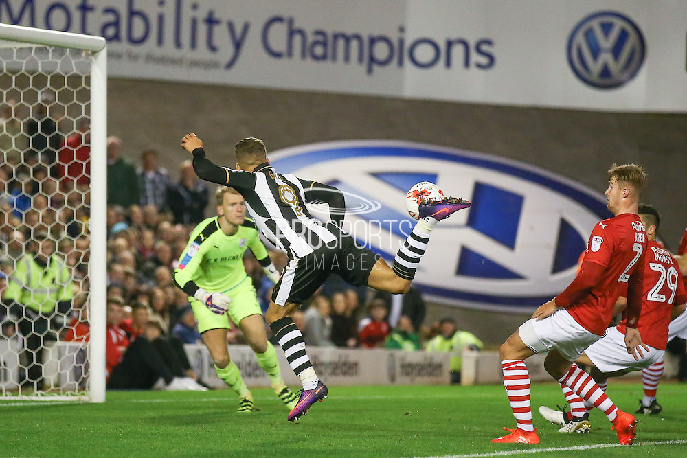 Newcastle United forward Dwight Gayle (9)  misses with cheeky back heel during the EFL Sky Bet Championship match between Barnsley and Newcastle United at Oakwell, Barnsley, England on 18 October 2016. Photo by Simon Davies.