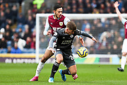 Leicester City midfielder Dennis Praet challenged by Burnley midfielder Dwight McNeil  during the Premier League match between Burnley and Leicester City at Turf Moor, Burnley, England on 19 January 2020.