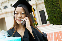 Graduate with Gift Using Cell Phone