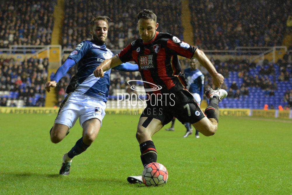 Birmingham City midfielder Andrew Shinnie attempts to block Bournemouth midfielder Marc Pugh cross during the The FA Cup third round match between Birmingham City and Bournemouth at St Andrews, Birmingham, England on 9 January 2016. Photo by Alan Franklin.