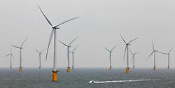 Embargoed to 0001 Tuesday October 18 File photo dated 23/09/10 of an offshore wind farm, as a report has warned that controls on green power subsidies, which are set to add £110 to household energy bills by 2020, have not delivered value for money.