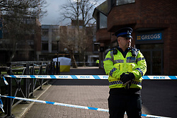 © Licensed to London News Pictures. 06/03/2018. Salisbury, UK. A police officer stands on a cordon at the scene near the Maltings shopping centre in Salisbury where former Russian spy Sergei Skripal and a woman in her 30s were taken ill with suspected poisoning. The couple where found unconscious on bench in Salisbury shopping centre. Specialist units have been called in to deal with any possible contamination. Photo credit: Ben Cawthra/LNP