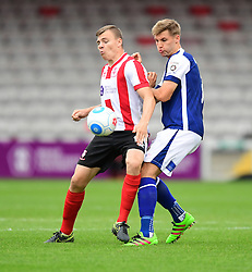 Lincoln City's Harry Anderson vies for possession with Barrow's Nick Anderton<br /> <br /> Picture: Chris Vaughan/Chris Vaughan Photography<br /> <br /> Football - Vanarama National League - Lincoln City Vs Barrow - Saturday 17th September 2016 - Sincil Bank - Lincoln<br /> <br /> Copyright © 2016 Chris Vaughan Photography. All rights reserved. Unit 11, Churchill Business Park, Bracebridge Heath, Lincoln, LN4 2FF - Telephone: 07764170783 - info@chrisvaughanphotography.co.uk - www.chrisvaughanphotography.co.uk