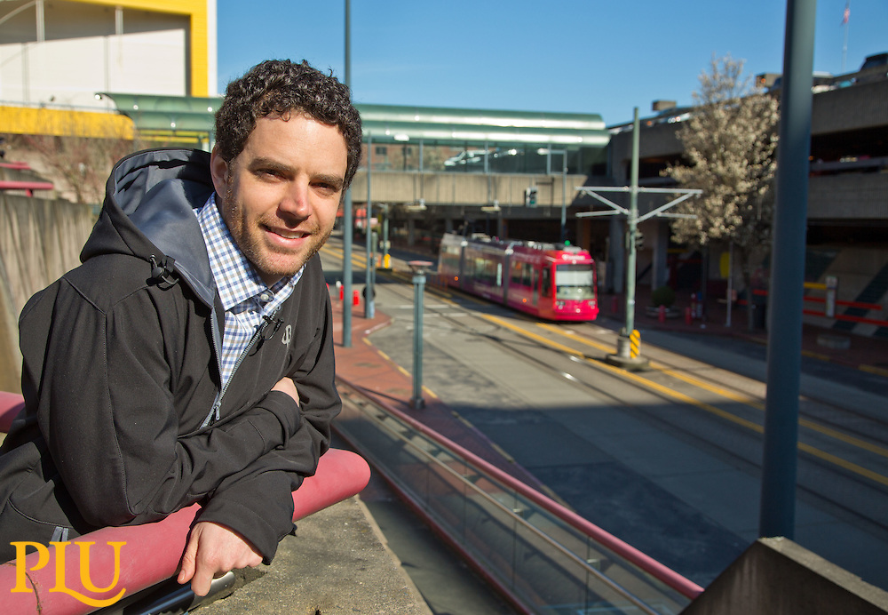 Andrew Austin '06, with and on public transit, an industry he promotes, on Tuesday, March 3, 2015. (Photo/John Froschauer)