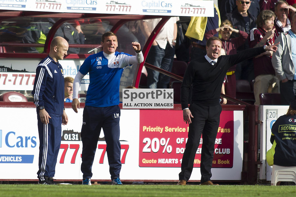 Kilmarnock manager Gary Locke and Lee McCulloch of Kilmarnock in the dugout during the Ladbrokes Scottish Premiership match between Heart of Midlothian FC and Kilmarnock FC at Tynecastle Stadium on October 4, 2015 in Edinburgh, Scotland. Photo by Jonathan Faulds/SportPix