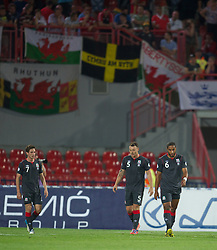 NOVI SAD, SERBIA - Tuesday, September 11, 2012: Wales' Joe Allen, Darcy Blake and Ashley Williams look dejected as Serbia score the second goal during the 2014 FIFA World Cup Brazil Qualifying Group A match at the Karadorde Stadium. (Pic by David Rawcliffe/Propaganda)
