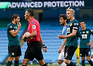 Ben Mee of Burnley protests to Referee Andre Marriner as VAR awards a penalty during the Premier League match at the Etihad Stadium, Manchester. Picture date: 22nd February 2020. Picture credit should read: Andrew Yates/Sportimage