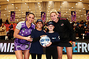 ANZ Future Captains Jordyn Paige Tukukino aged 9 and Teina Davidson aged 9 pose for a photo with Grace Kara of the Stars and Casey Kopua of the Magic prior to the match. 2018 ANZ Premiership netball match, Stars v Magic at Pulman Arena, Auckland, New Zealand. 4 July 2018 © Copyright Photo: Anthony Au-Yeung / www.photosport.nz