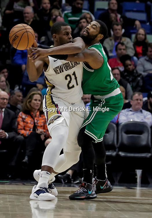Nov 26, 2018; New Orleans, LA, USA; Boston Celtics guard Kyrie Irving (11) defends against New Orleans Pelicans forward Darius Miller (21) during the second half at the Smoothie King Center. Mandatory Credit: Derick E. Hingle-USA TODAY Sports
