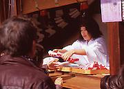 A shrine worker sells lucky cloths before the beginning of the Naked Man Festival (Hadaka Matsuri) in Kounomiya, Nagoya.