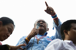 © Licensed to London News Pictures. 16/05/2014. PDRC leader Suthep Thaugsuban makes a speech and points to the crowd during a rally outside Parliament in Bangkok Thailand where key senators were holding a meeting on May 16, 2014.  Photo credit : Asanka Brendon Ratnayake/LNP