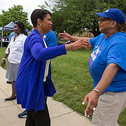 WASHINGTON, DC -JUNE4:  Council member Yvette Alexander (D-Ward 7) hugs Mayor Muriel Bowser at a community day in the Parkside neighborhood, June 4, 2016. Alexander is in the fight for her political life as her one time mentor and former Mayor Vincent Gray mounts a comeback, assailing her for poor constituent services, failure to respond to rising crime in the ward and bungling oversight of St. Elizabeths hospital and DC trust. (Photo by Evelyn Hockstein/For The Washington Post)