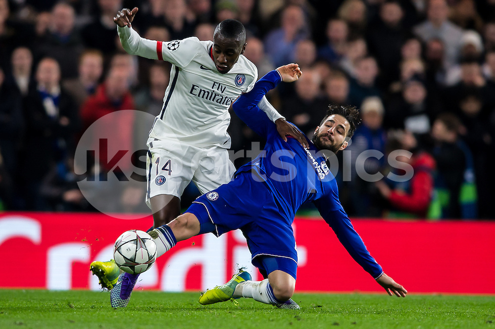 Blaise Matuidi of Paris Saint-Germain is tackled by Cesc Fabregas of Chelsea during the UEFA Champions League Round of 16 Game 2 match between Chelsea and Paris Saint-Germain at Stamford Bridge, London, England on 9 March 2016. Photo by Salvio Calabrese.