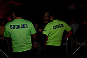 BOUNCERS IN GEEN T SHIRTS SMILING SAYING BOUNCER