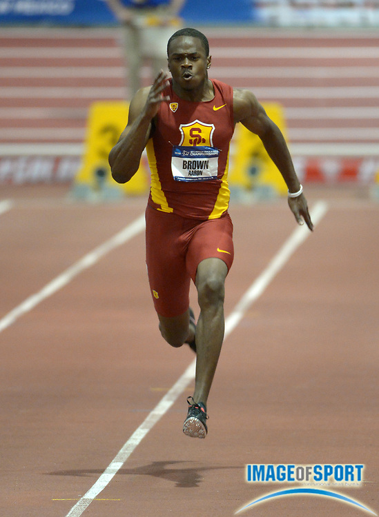 Mar 14, 2014; Albuquerque, NM, USA; Aaron Brown of Southern California runs 6.60 in a 60m heat in the 2014 NCAA Indoor Championships at Albuquerque Convention Center.