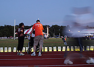 Goshen, New York - People walk laps around the track, which is lined with luminaria in remembrance of cancer victims, during the Relay for Life at Goshen High School on June 19, 2011. The Relay for Life is the American Cancer Society's signature fundraising event. Participants celebrate the lives of people who have battled cancer, remember loved ones lost, and fight back against the disease by raising money. The walkers at right are blurred because of their movement during the long exposure.
