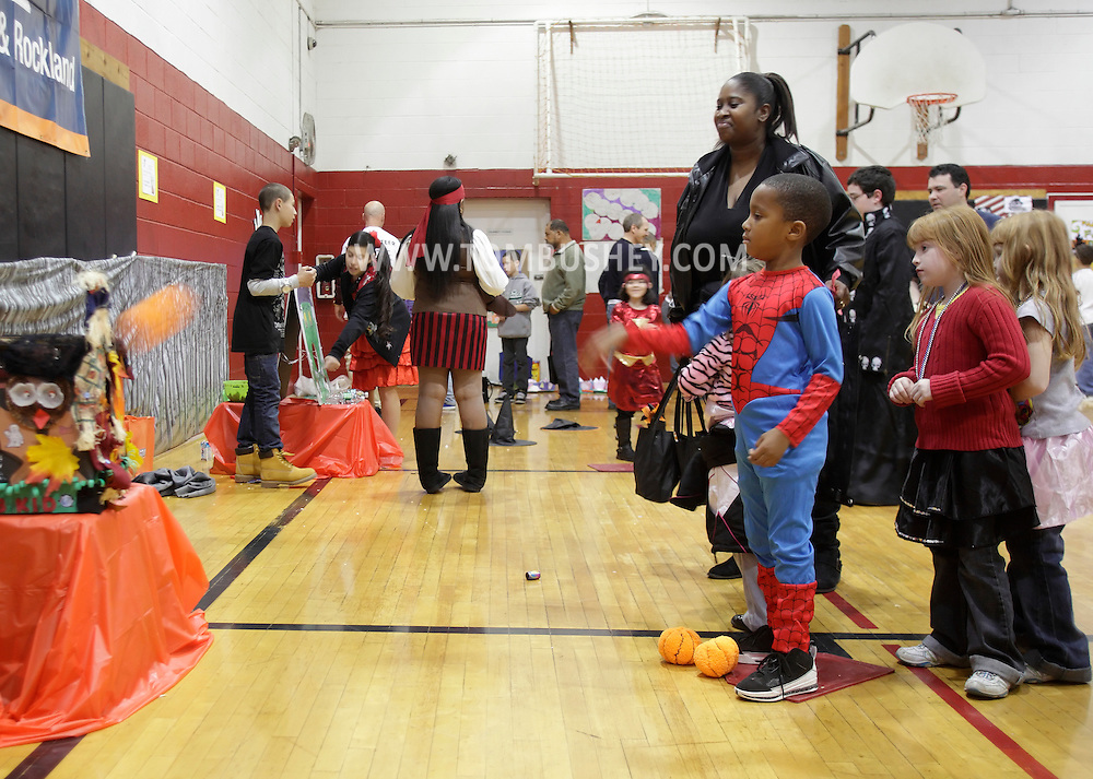 Middletown, New York - Children wearing costumes play games at the Family Fall Festival at the Middletown YMCA on Oct. 23, 2010. ©Tom Bushey / The Image Works