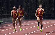 Mar 18, 2017; Los Angeles, CA, USA; Kendall Ellis of Southern California wins the women's 200m in 22.79 during the Trojan Invitational at Cromwell Field. From left: Destinee Brown and Ellis and Ky Westbrook.