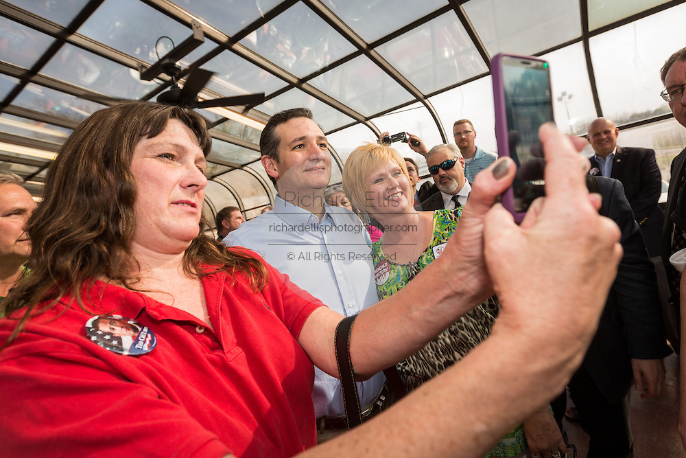 U.S. Senator Ted Cruz and GOP presidential candidate talks a selfie with supporters following a town hall meeting at the famous Beacon Drive-in restaurant before April 3, 2015 in Spartanburg, South Carolina.