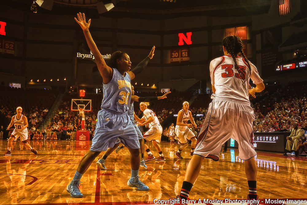 University of Nebraska women's basketball player Rachel Theriot inbounds the ball during game against Southern University. Photo by Mosley Images.