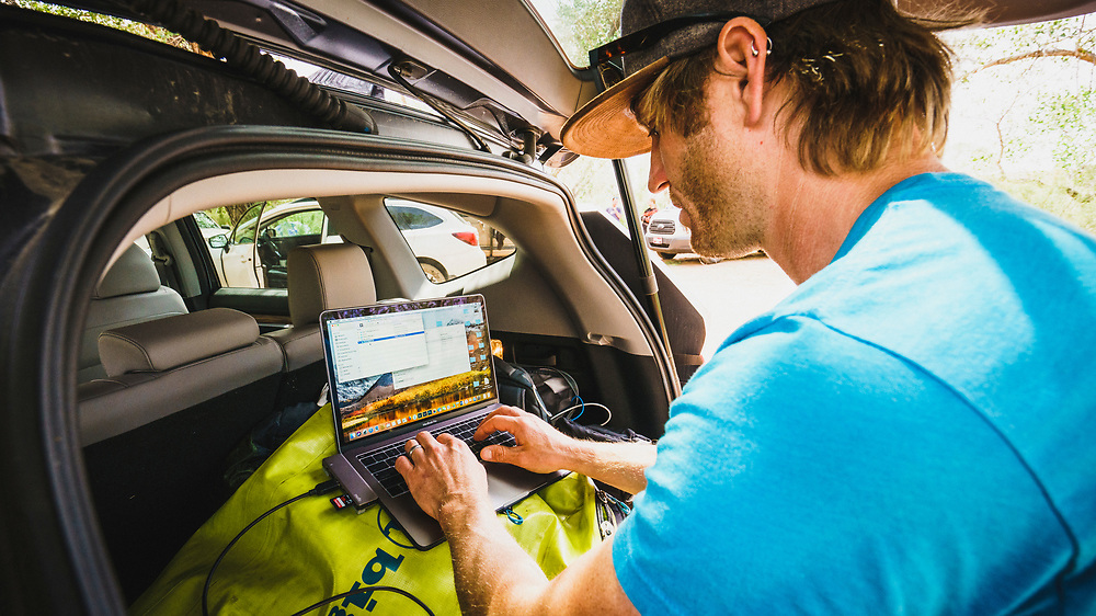 Dane Cronin working out of the back of his car, Virgin, Utah.