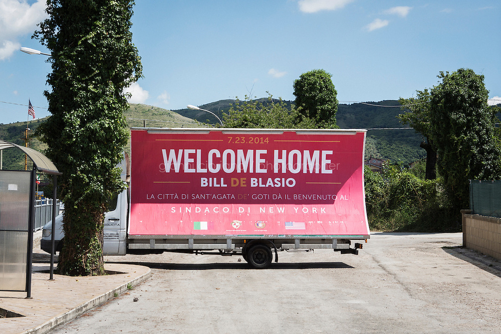 SANT'AGATA DE GOTI, ITALY - 23 JULY 2014: A mobile billboard welcomes Mayor of New York Bill De Blasio back home, at the entrance of Sant'Agata de Goti, his ancestral home town in Italy, on July 23rd 2014.<br /> <br /> New York City Mayor Bill de Blasio arrived in Italy with his family Sunday morning for an 8-day summer vacation that includes meetings with government officials and sightseeing in his ancestral homeland.