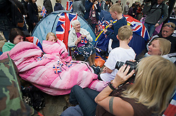 © licensed to London News Pictures.  28/04/2011. London, UK.  Today (28/05/2011) The day before the Royal Wedding fans gather outside Westminster Abbey to celebrate the monumental occasion. Photo  credit should read LNP.