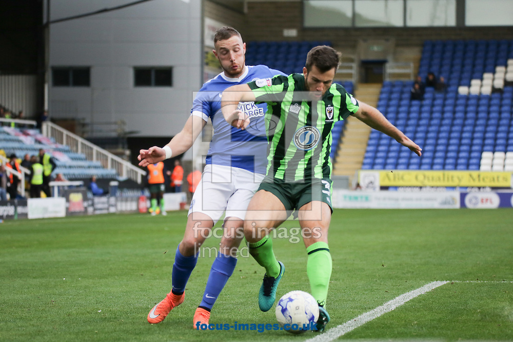 John Meades of AFC Wimbledon battles with Peterborough Player during the Sky Bet League 1 match at London Road, Peterborough<br /> Picture by Glenn Sparkes/Focus Images Ltd 07939664067<br /> 22/10/2016