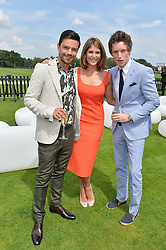 Left to right, DOMINIC COOPER, GEMMA ARTERTON and EDDIE REDMAYNE at the Audi International Polo at Guards Polo Club, Windsor Great Park, Egham, Surrey on 26th July 2014.