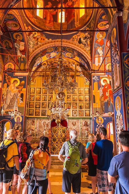 Visitors and docent in the abbey chapel, Krka Monastery, Krka National Park, Dalmatia, Croatia