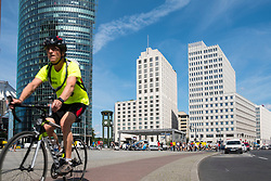 Cyclist in Potsdamer Platz on cycle way in Berlin , Germany
