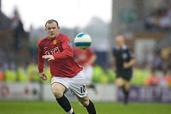 WIGAN, ENGLAND - Sunday, May 11, 2008: Manchester United's Wayne Rooney in action against Wigan Athletic during the final Premiership match of the season at the JJB Stadium. (Photo by David Rawcliffe/Propaganda)