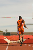Pole-vaulter running with pole