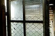 windowed door in an old wooden shed